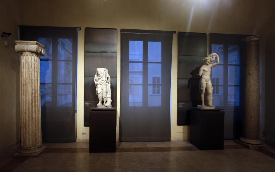 "Some of the marble statues that were covered up with wooden panels on the occasion of Iranian President Hassan Rouhani's visit are seen at the Capitoline Museums, in Rome, Tuesday, Jan. 26, 2016. A kind of "" classics coverup "" is causing a political flap in Italy, after ancient nude statues in a museum were hidden from view so the Iranian president would not take offense. (AP Photo/Gregorio Borgia)"