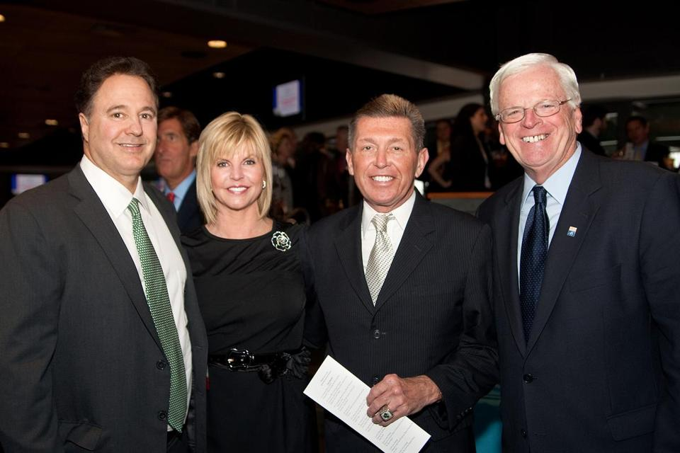 Julie Kahn, a Regan employee who says she plans to step off the Suffolk board when her term expires this spring, with (from left) Celtics co-owner Steve Pagliuca, George Regan, and Suffolk trustee Bob Sheridan at an event at Fenway Park in 2011.