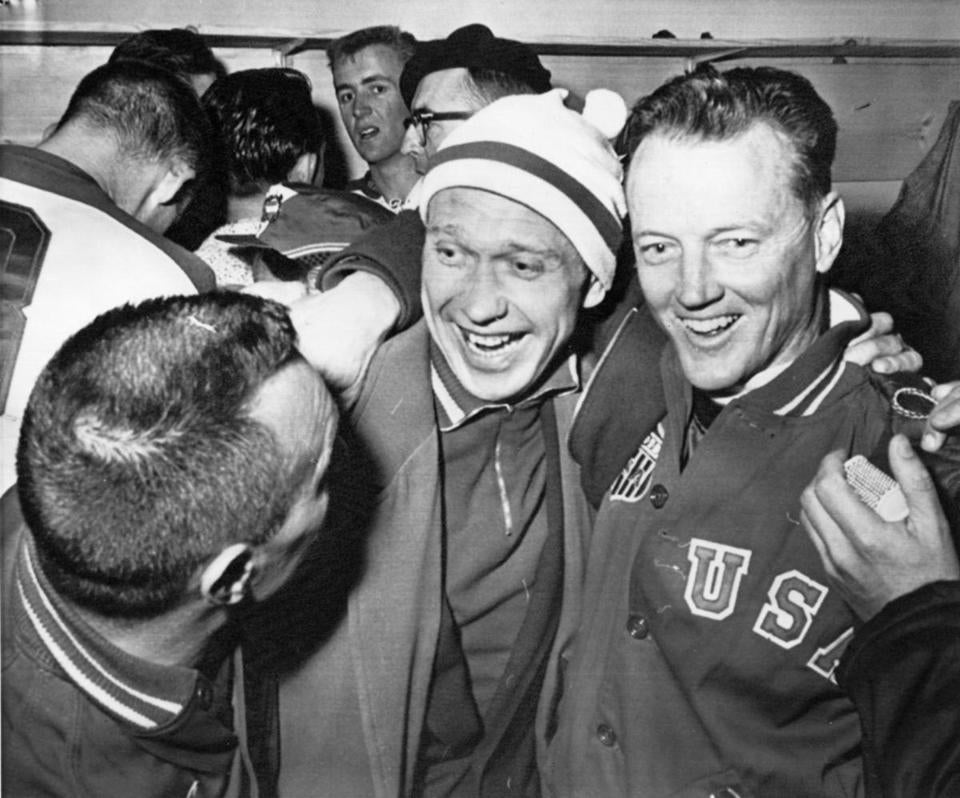 Jack Riley (right), coach of the US hockey team, hugged Russian team captain Nikolai Sologubov at the 1960 Games.