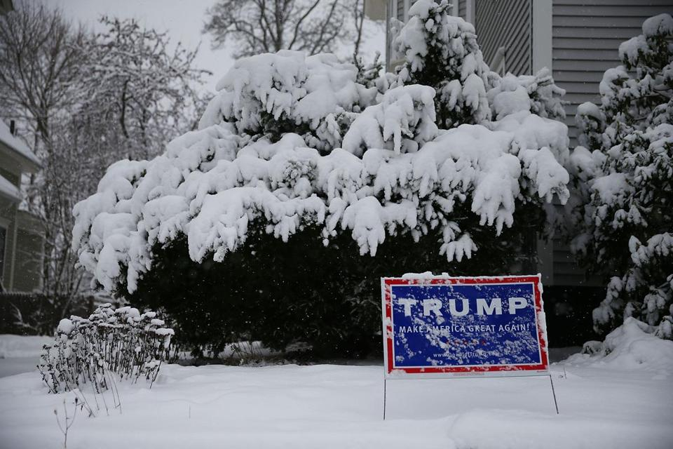 A campaign sign for Republican presidential candidate Donald Trump is seen during Friday's storm in Concord, N.H.