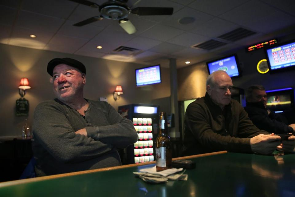 "Jimmy Maher, left, sits with owner Bill ""Touchie"" McDonough at the Shamrock Pub on EighthStreet in South Boston."