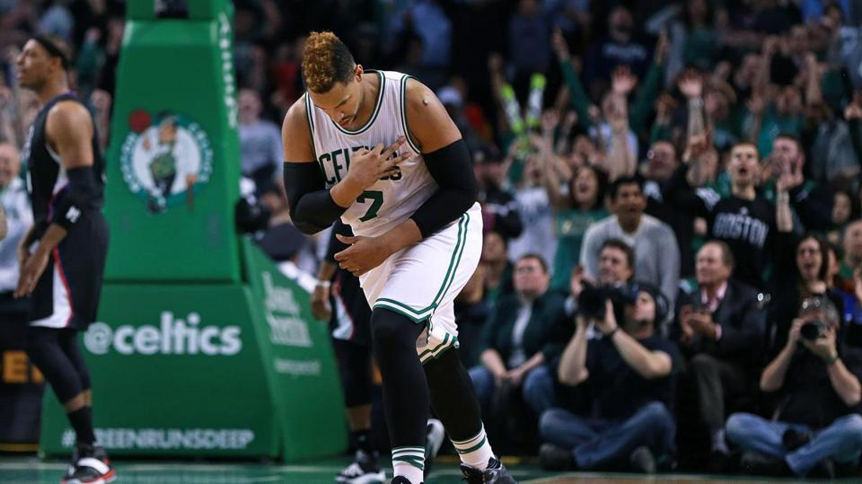 02/10/16: Boston, MA: The Celtics Jared Sullinger reacts as he brings the crowd out of their seats after he hit a shot during the overtime period. The Clippers Paul Pierce is in the backround at far left. The Boston Celtics hosted the Los Angeles Clippers in a regular season NBA basketball game at the TD Garden. (Globe Staff Photo/Jim Davis) section:sports topic:Celtics-Clippers