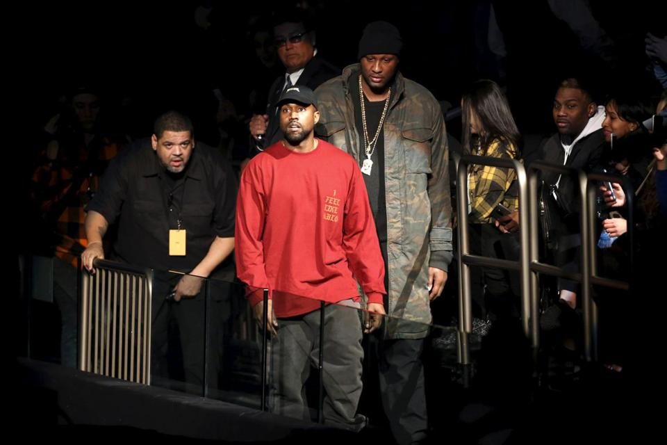 094a178a5d9f76 Kanye West (center) and Lamar Odom arrived at West s Yeezy Season 3  presentation and