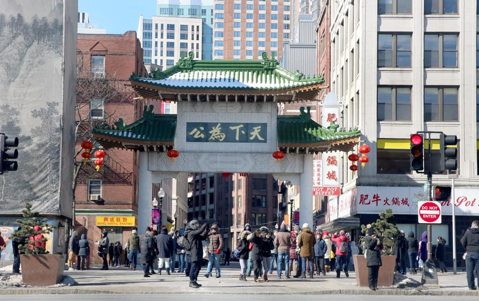 Boston, MA--2/14/2016--The Chinese New Year parade and celebration scheduled for Sunday, February 14, 2016 was postponed one week. In spite of the singe-digit temperature, people did gather for a while around the entrance to Boston's Chinatown. Photo by Pat Greenhouse/Globe Staff Topic: 15newyear Reporter: XXX
