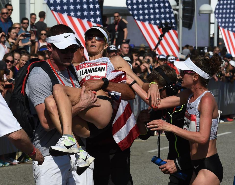 Shalane Flanagan finished third, but needed help after finishing as concerned winner Amy Cragg looked on.