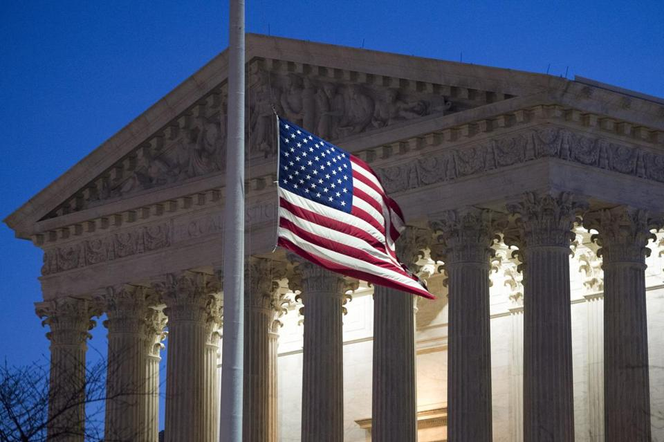 The US flag flew at half-staff early Sunday in front of the US Supreme Court.