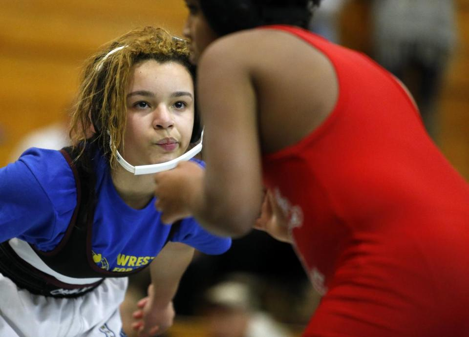 Boston, MA - 2/14/2016 - Boston Youth Wrestling's Kayla Lee, a seventh grader, sized up her opponent during a wrestling meet at Madison Park High School in Boston, MA February 14, 2016. Jessica Rinaldi/Globe Staff Topic: wrestling Reporter: