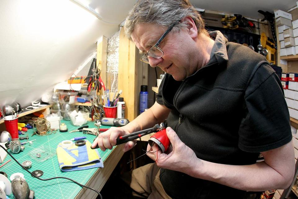 James Waldron working on a custom microphone he designed for use with a harmonica.