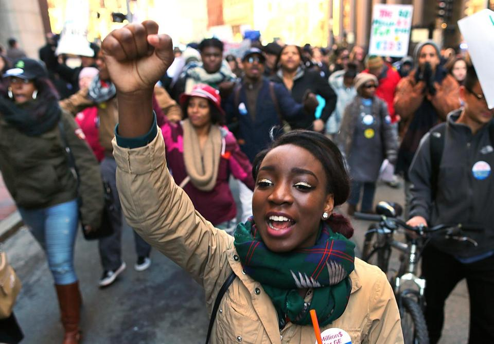 Boston-02/17/16 Jade Williams, a sophomore at Burke High School leads a march down Tremont Street to the State House from Boston City Hall. Hundreds of students and teachers rallied in front of Boston City Hall and marched to the State House as part of a national day of action to protest cuts to public education.Boston Globe staff photo by John Tlumacki(metro)