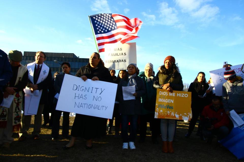 Protestors with signs outside of the ICE regional office in Burlington, during a protest on Wednesday, February 17, 2016 in concurrent with Pope Francis and Cardinal O'Malley's Vigil at the US-Mexican Border.