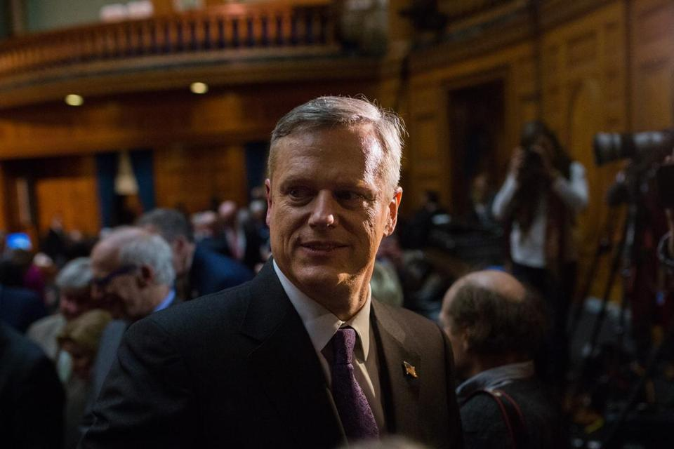 Boston, MA - 1/21/2016 - Massachusetts Governor Charlie Baker greets members of the legislature as he walks through the chambers of the Massachusetts State House after delivering his first State of the Commonwealth speech in Boston, MA, January 21, 2016. (Keith Bedford/Globe Staff)
