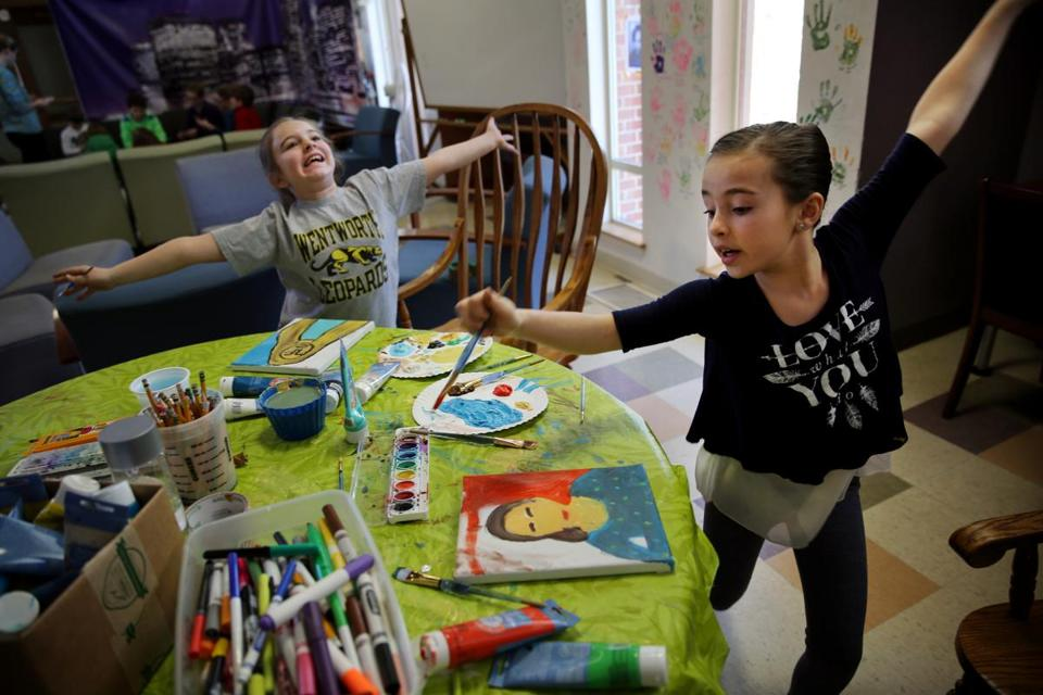 "From Left: Ania Manning, 9, and Autumn Cooney danced while painting self-portraits during ""Selfie Camp"" at the Duxbury Student Union."