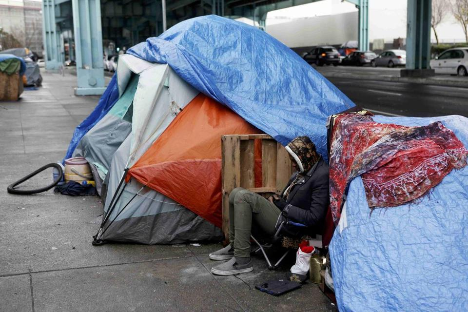 A homeless man took shelter under a freeway during an El Nino driven storm in San Francisco in January.