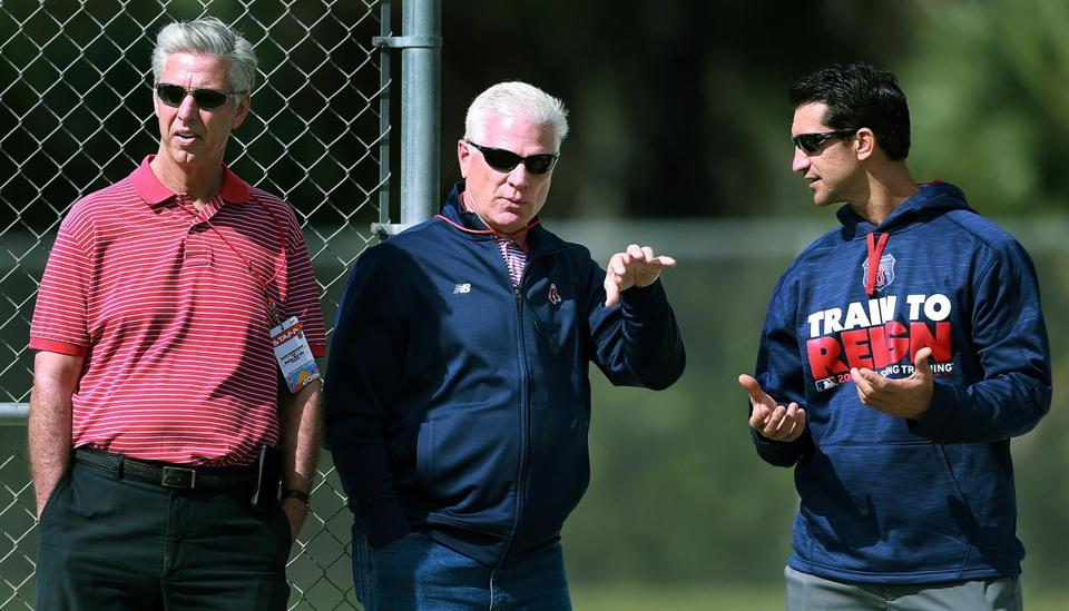 From left: Red Sox executives Dave Dombrowski, Frank Wren and Mike Hazen hung out together while watching pitchers threw in the bullpen Friday.