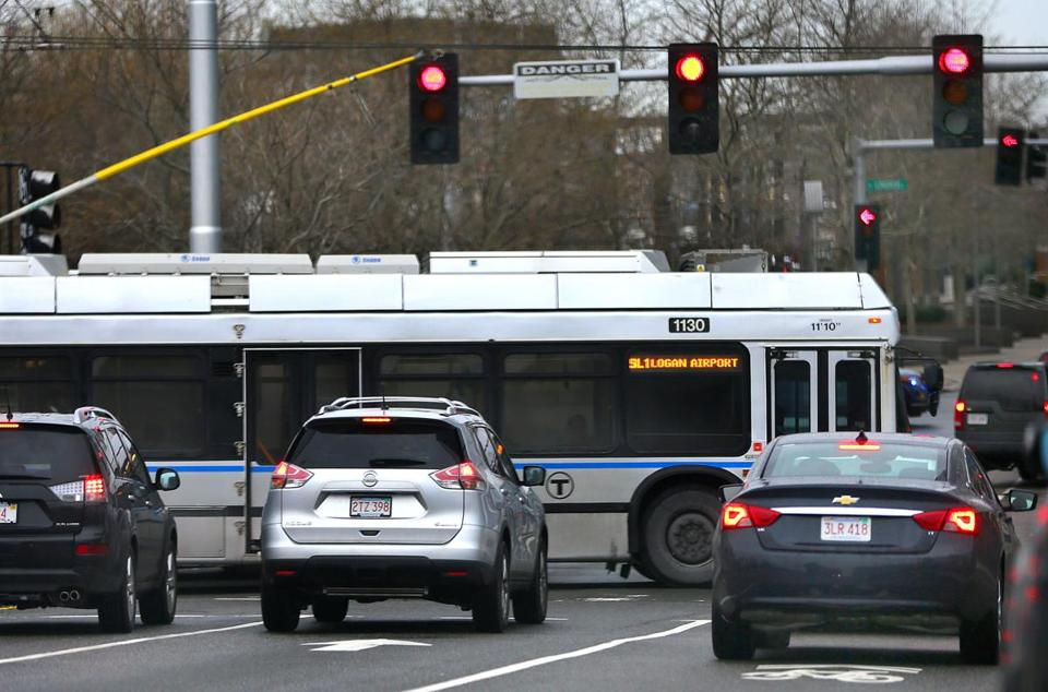 A Silver Line bus crossed D Street as it traveled along Silver Line Way. Officials have tweaked the light cycle here after motorists' complaints.