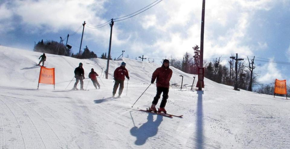 Crowds have been absent from New England ski slopes as a lack of snow and nights too warm for snow making have left the mountains with much less cover than in an average winter.