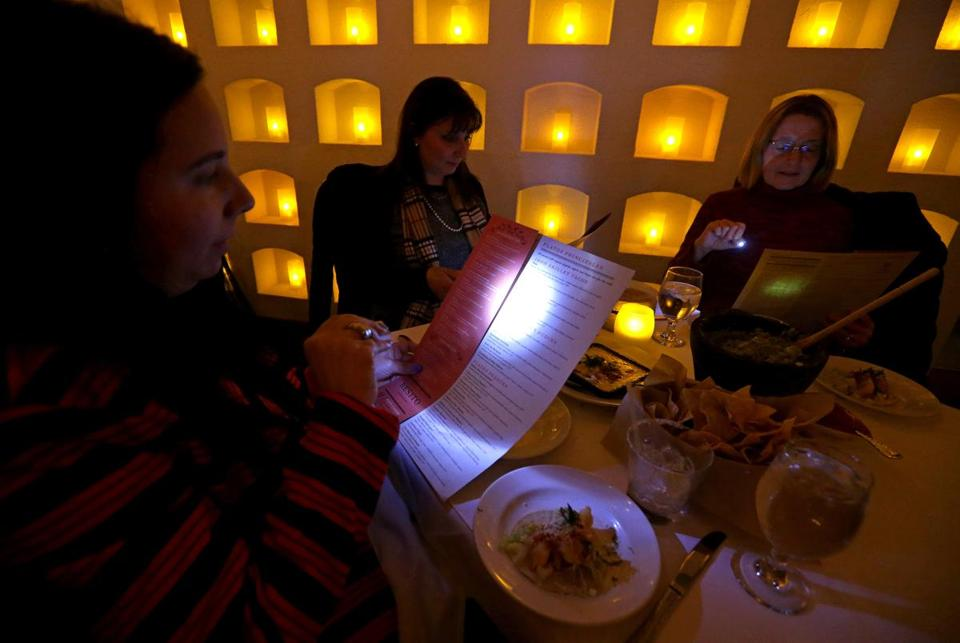 Besito in Chestnut Hill offers guests mini flashlights to help them read the menu.