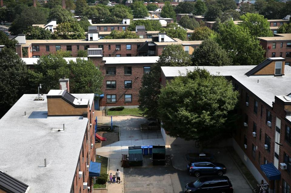 Tens of thousands of formerly low-income individuals and families, including several hundred in Massachusetts, still live in government-subsidized homes even though they now make too much money to qualify, federal officials said. Above: the Bunker Hill development in Charlestown.