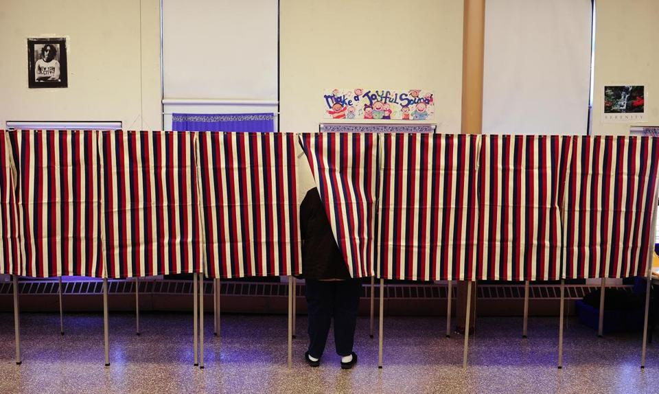 A voter cast her ballot at a polling station in Cambridge in 2012.