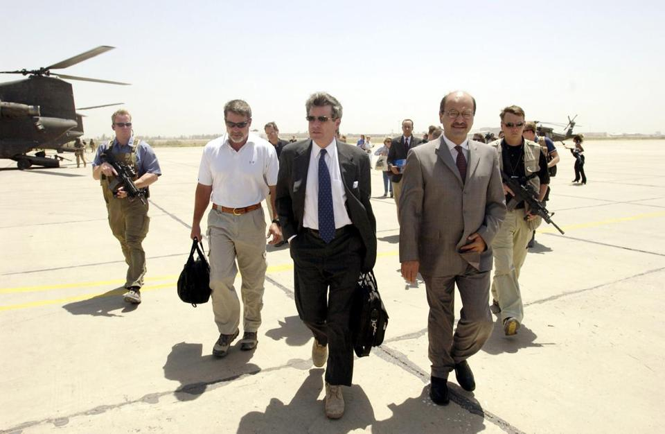 Ambassador L. Paul Bremer and Iraqi Deputy Prime Minister Barham Saleh walk to the Baghdad International Airport before the ambassador makes his final departure from Iraq after he signed the Iraqi Sovereignty document that gave full governmental authority to the Iraqi interim government in Baghdad, Iraq, June 28, 2004. The ambassador left on an Army Chinook helicopter, arrived at Baghdad international airport and made his final departure from Iraq in a U.S. Air Force C-130. (U.S. Air Force photo by Staff Sgt. D. Myles Cullen) (Photo by United States Air Force/WireImage)