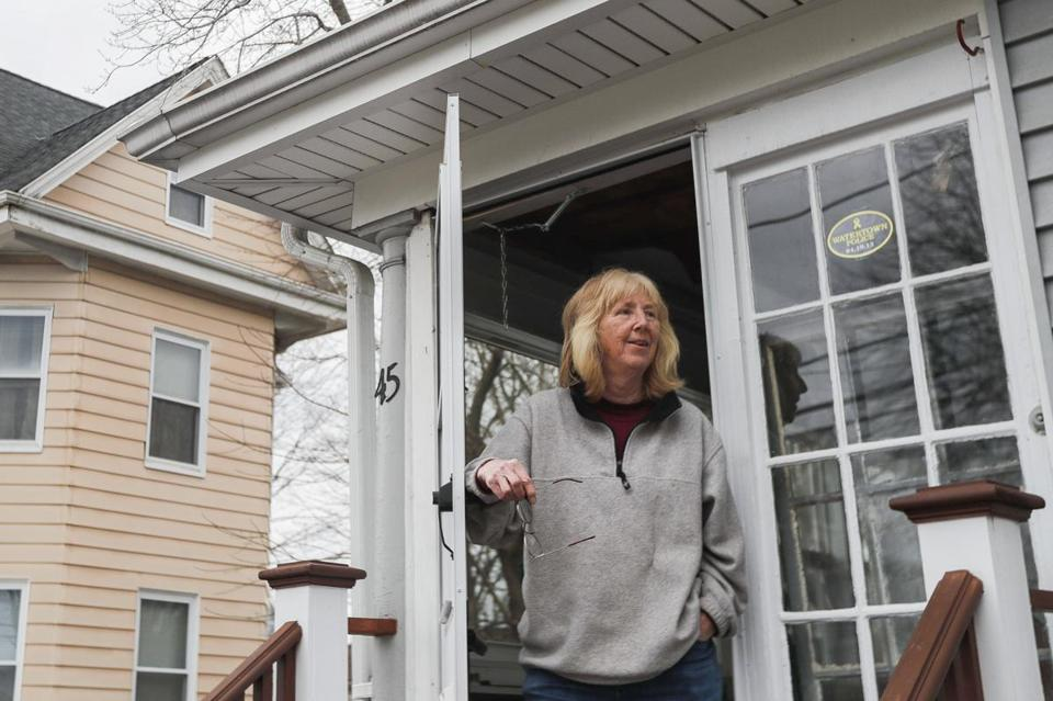 "Watertown, MA - 2/23/2016 - Jean McDonald looks out from her home on Laurel Street where a shoot out with police and the Boston Marathon bombers Dzhokhar and Tamerlan Tsarnaev occurred in Watertown, MA, February 23, 2016. Film makers are seeking approval from residents in the neighborhood to re-create the event for the film ""Patriot's Day"" (Keith Bedford/Globe Staff)"