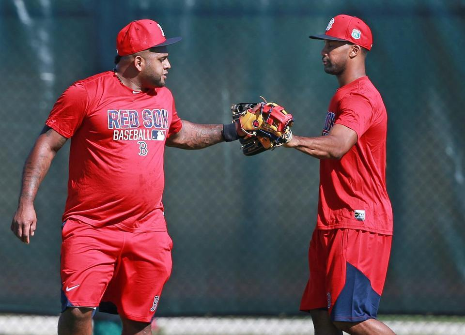 Pablo Sandoval, left, said hello to new teammate Chris Young during his first day at spring training on Sunday.