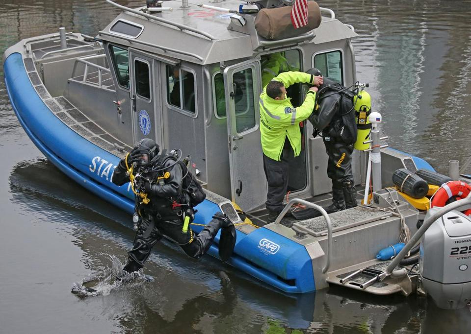 BOSTON, MA - 2/24/2016: Diving in......State Police dive team continue to search for missing Zach Marr under Zakim bridge and Charle River dam. (David L Ryan/Globe Staff Photo) SECTION: METRO TOPIC 25missingpic