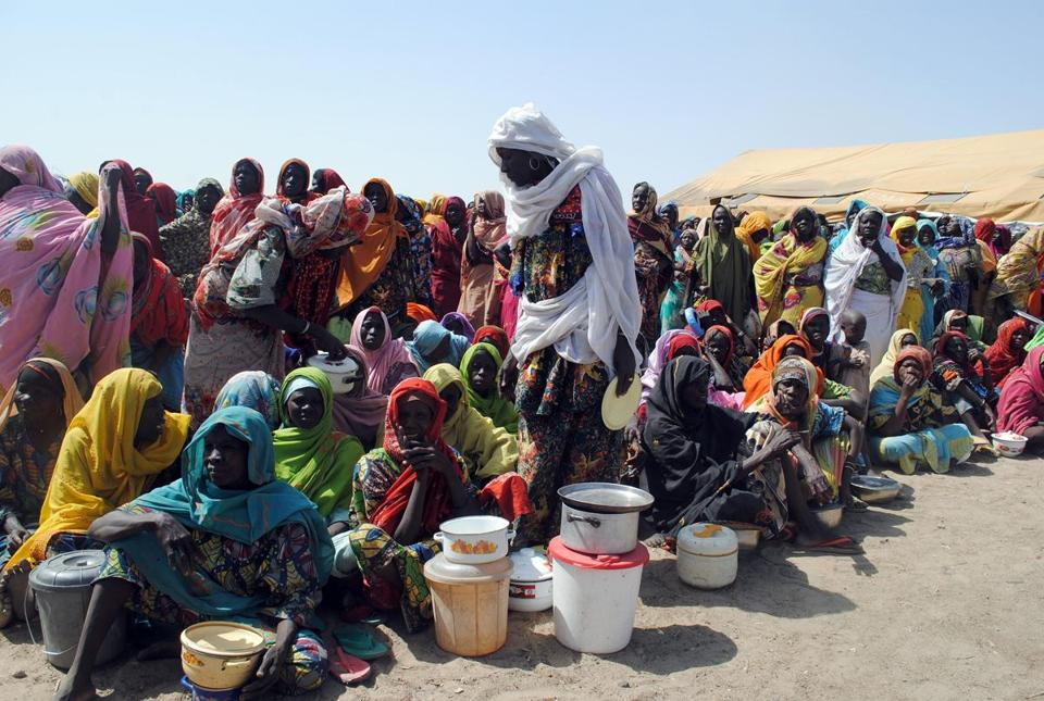 Internally displaced persons waited to be served with food at Dikwa Camp, in Borno state in north-eastern Nigeria last month.