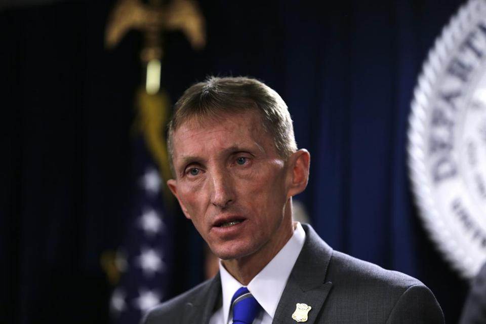 "Boston Police Commissioner William Evans speaks during a news conference in Boston, Friday, Jan. 29, 2016. Authorities say they have charged 56 members of the MS-13 gang in and around Boston. The gang is notoriously violent and known for using machetes to kill victims. According to court documents, in 2012, MS-13 became the first and remains the only street gang to be designated by the U.S. government as a ""transnational criminal organization."" (AP Photo/Charles Krupa)"