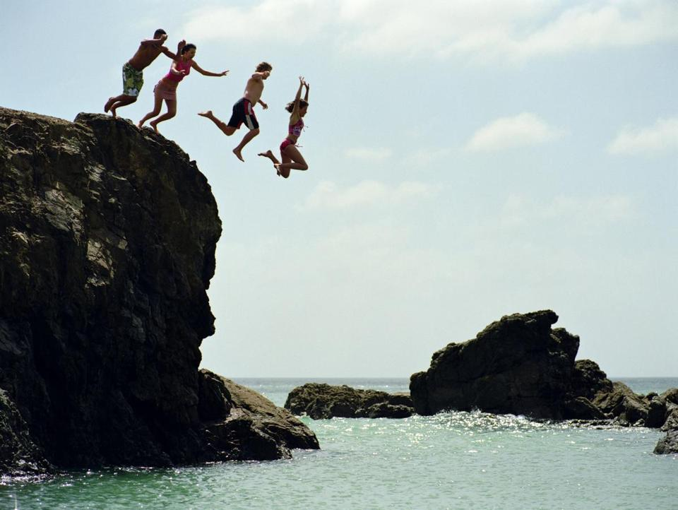 Jumping off rocks in New Zealand.