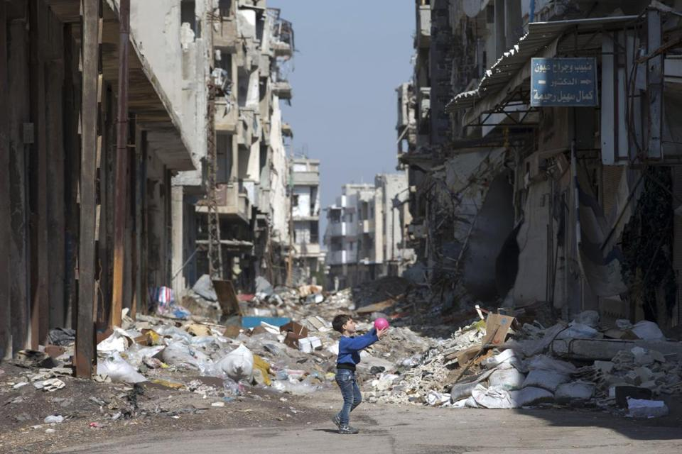 A Syrian boy played between destroyed buildings in the old city of Homs, Syria, on Friday.