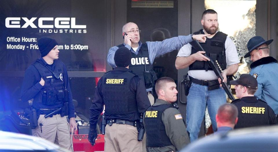 Police guarded the front door of Excel Industries in Hesston, Kan., on Thursday after a shooting rampage.