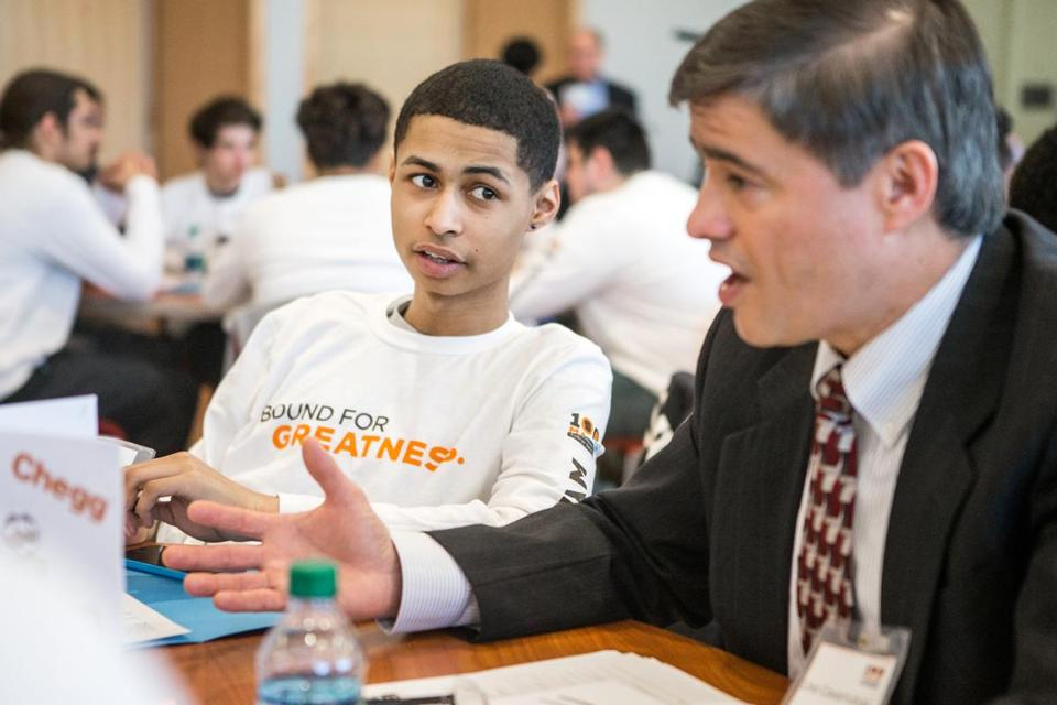02/26/2016 FRAMINGHAM Victor Amaker (cq) (left) 17, of Framingham High, listens to mentor Lino Covarrubias (cq) during launch day for the 100 Males to College program held at Framingham State University. (Aram Boghosian for The Boston Globe)