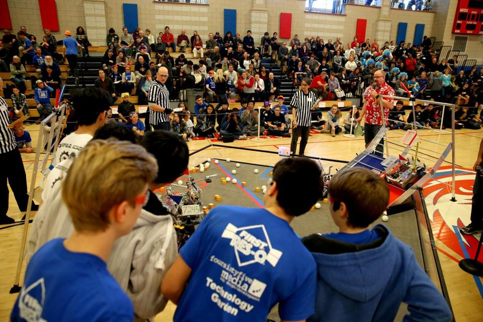 Team Infinity Factor watches their robot during competition at the Massachusetts First Tech Challenge State Championships at Natick High School.