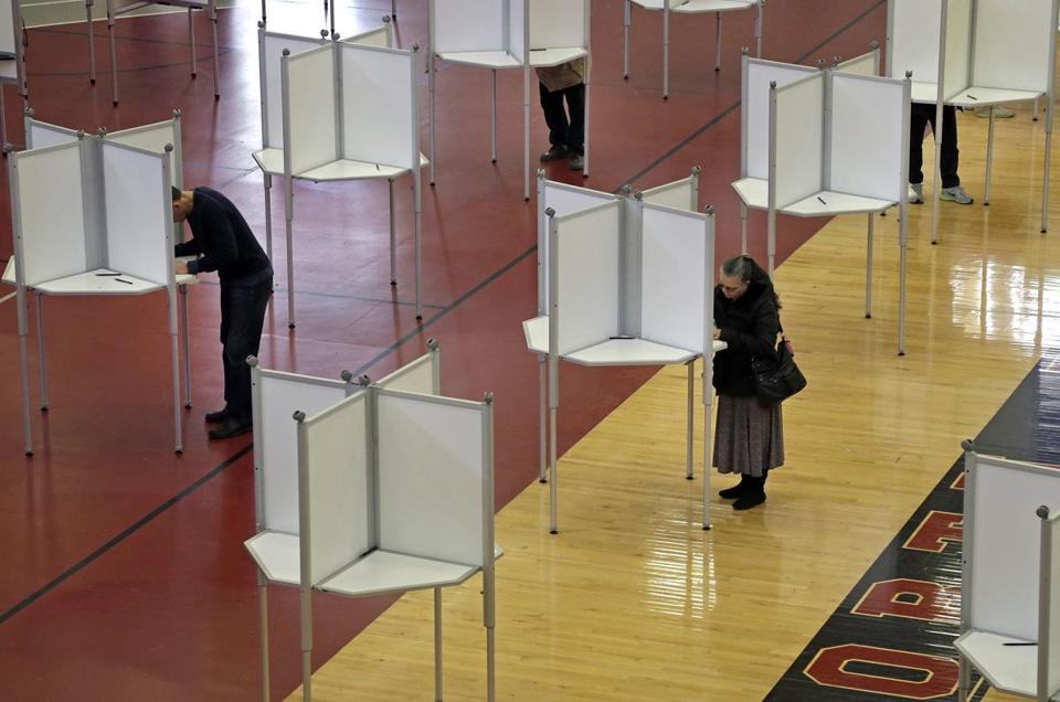 Voters cast ballots at a polling station for Massachusetts' primary election, Tuesday, March 1, 2016, in North Andover, Mass. Voters from Vermont to Colorado, Alaska to American Samoa and a host of states in between are heading to polling places and caucus sites on the busiest day of the 2016 primaries. (AP Photo/Elise Amendola)