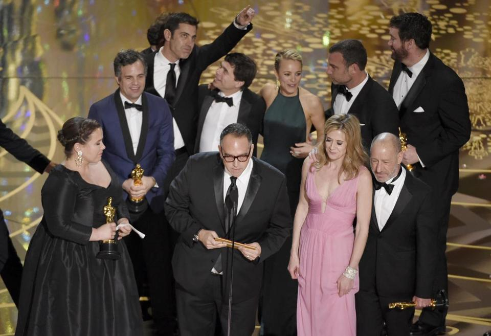 "CAPTION ADDITION TO ADD MORE IDS - Nicole Rocklin, front row from left, Michael Sugar, Blye Pagon Faust, Steve Golin, and, second row from left, Mark Ruffalo, Josh Singer, Michael Rezendes, Rachel Mc Adams and Liev Schrieber appear on stage to accept the award for best picture for ""Spotlight"" at the Oscars on Sunday, Feb. 28, 2016, at the Dolby Theatre in Los Angeles. (Photo by Chris Pizzello/Invision/AP)"