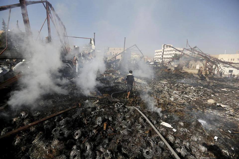 A man walked on the rubble of an electronics warehouse store after a Saudi-led air strike destroyed it in Yemen's capital Sanaa Feb. 14, 2016.