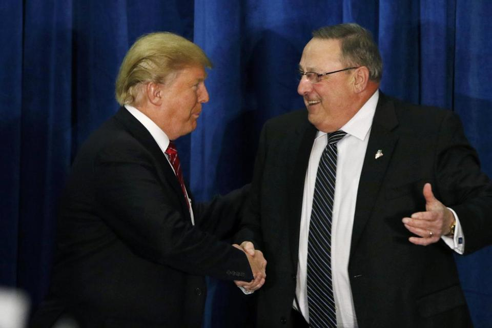 Republican presidential candidate Donald Trump shook hands with Maine Governor Paul LePage after LePage introduced him at a campaign rally in Portland, Maine.