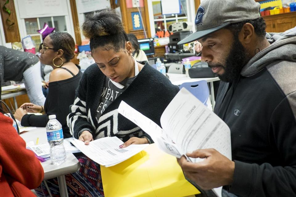 Kiyana Scott and Paul Bagby reviewed their son's progess at Beers Elementary School in Washington.