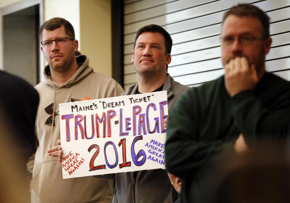 Maine voter Michael Hein held a sign expressing his desire to see Maine Governor Paul LePage chosen to run as a vice presidential nominee with Donald Trump in the presidential election.