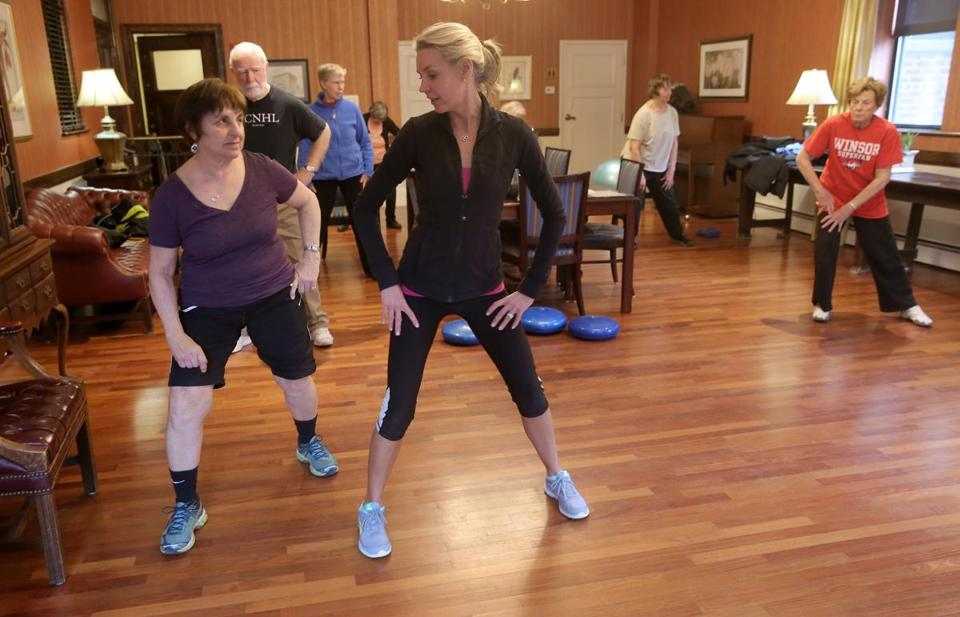 Instructor Cindy Sullivan gives pointers to Rita Horgan, 70, in an exercise class set up by Beacon Hill Village, an organization for people over 50.