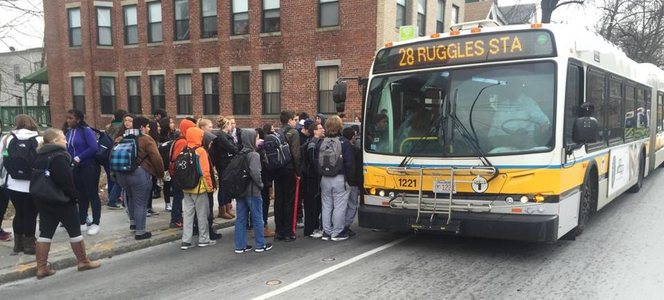 08bps- 3/7/2016- Boston public school students are participating in a walkout Monday and a demonstration at the State House as part of a national protest against proposed budget cuts here and in several other cities. The walkout began at about 11:30 a.m. At Boston Latin Academy, more than 100 students gathered at the corner of Quincy and Warren streets, packing an MBTA bus headed downtown as they sought to convey their worries about how spending reductions could affect their education.(Pat Greenhouse/Globe Staff)