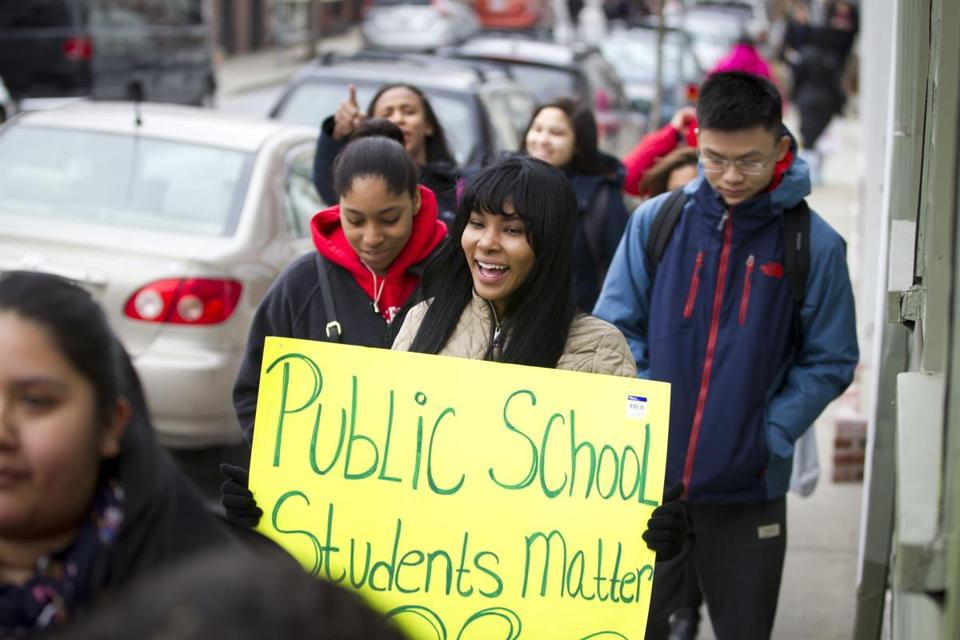3/7/2016 - Charlestown, MA - Lorena Paulino, cq, (center with sign) a senior at Charlestown High School was among the dozens of Charlestown High School students who participated in a walk out on Monday morning, March 7, 2016 to protest public school funding cuts. Topic: 08bps. Story by Jan Ransom/Globe Staff. Photo by Dina Rudick/Globe Staff