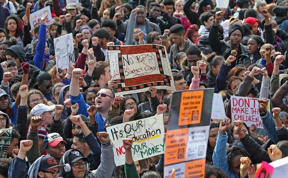 On Monday thousands of Boston public school students walked out of their classes and marched to the State House to protest the School Department's proposed budget cuts.