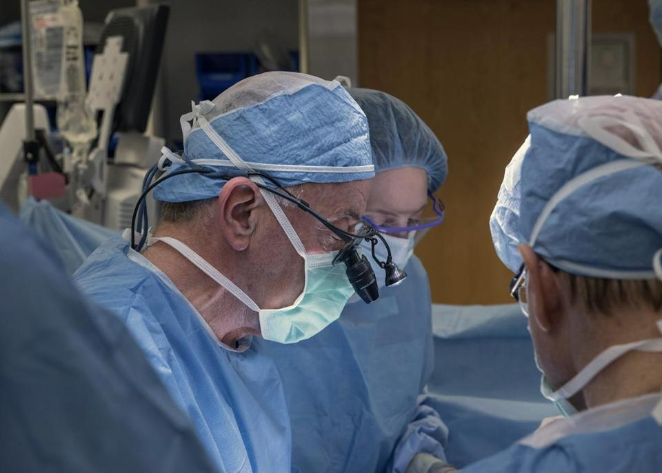 Surgeon wearing surgical caps while at work at Cleveland Clinic Center in March.