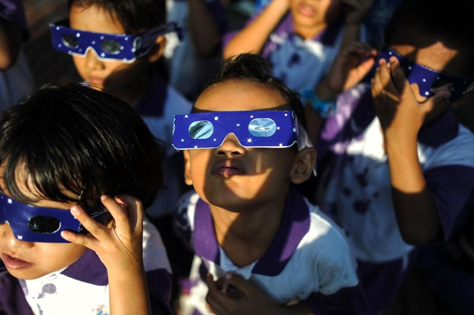 Malaysian school children wore glasses with special filters watch the partial solar esclipse at the National Planetarium in Kuala Lumpur in 2016.