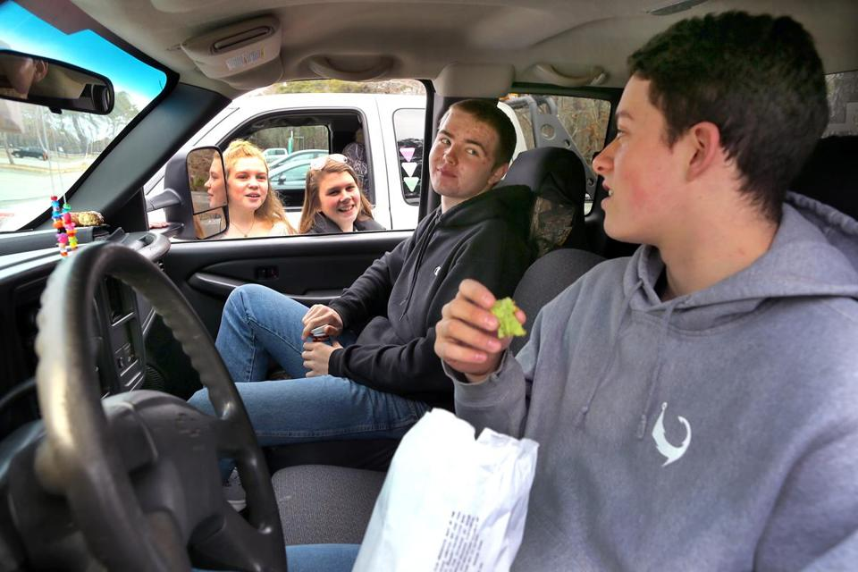 Nauset High School student Branden Patterson (right), 17, and a group of his friends show up to school early most mornings, drink coffee in their pickup trucks, and listen to country music while they wait until classes begin.