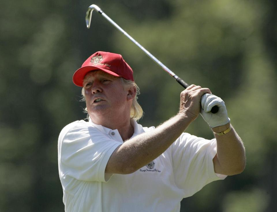 Donald Trump watches his fairway shot on the second hole during the Pro-Am round of the Deutsche Bank Championship golf tournament, in Norton, Mass., Thursday Aug. 30, 2007.(AP Photo/Charles Krupa)