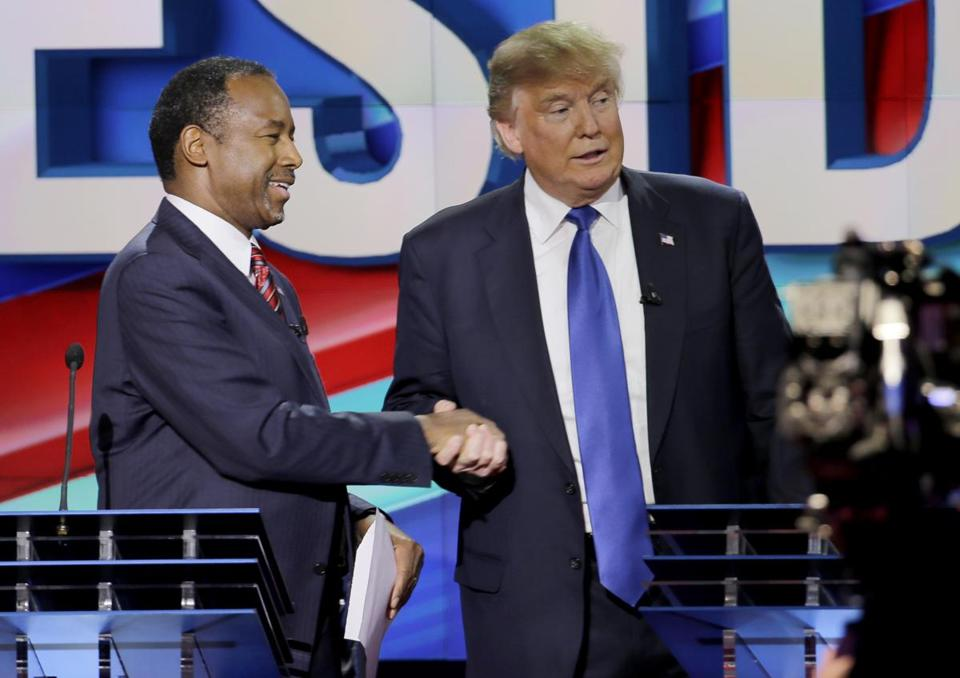 Republican presidential candidate, retired neurosurgeon Ben Carson, left, and Republican presidential candidate, businessman Donald Trump shake hands after a Republican presidential primary debate at The University of Houston, Thursday, Feb. 25, 2016, in Houston. (AP Photo/David J. Phillip)