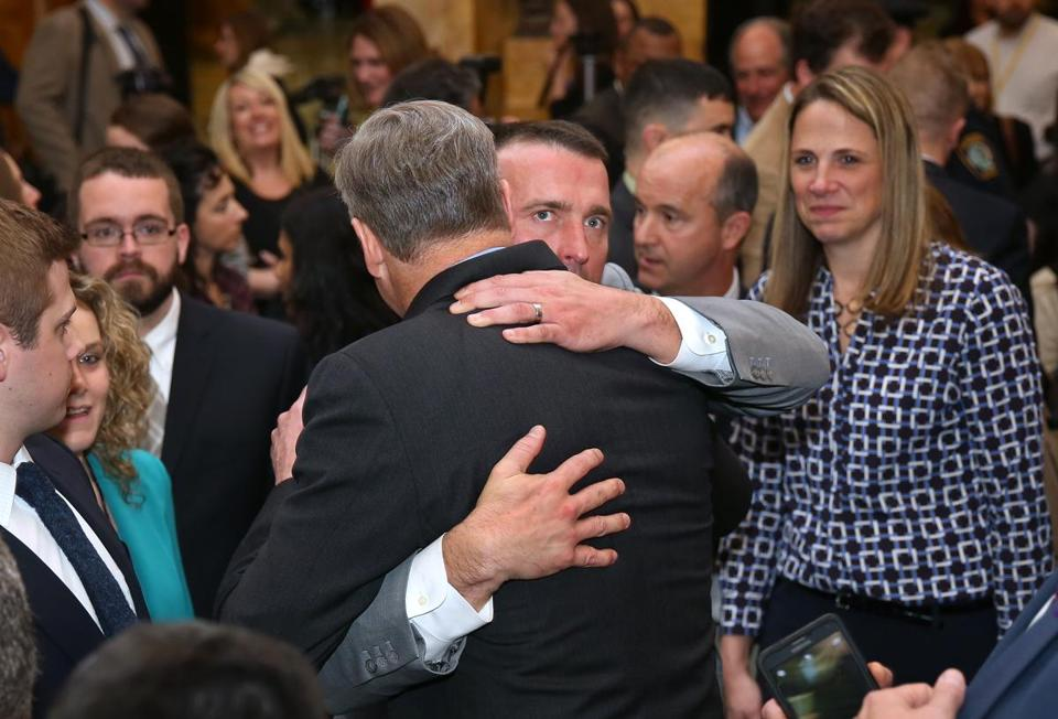 Governor Charlie Baker embraced Chris Herren, a former Celtics player and recovering addict.